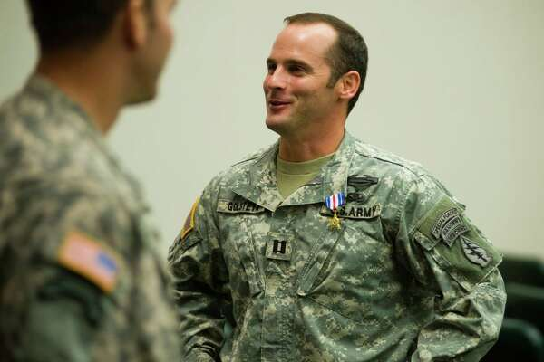 U.S Army Capt. Mathew Golsteyn is congratulated by fellow soldiers following a 2011 ceremony at Fort Bragg, N.C.