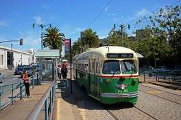A streetcar painted in tribute to Philadelphia runs along the San Francisco waterfront in July.