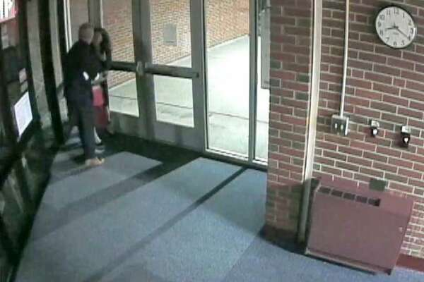 This video still from a DVD sent anonymously to the Cromwell Board of Education this week reportedly shows Superintendent of Schools John T. Maloney and Assistant Superintendent Krista Karch engaging in inappropriate contact.