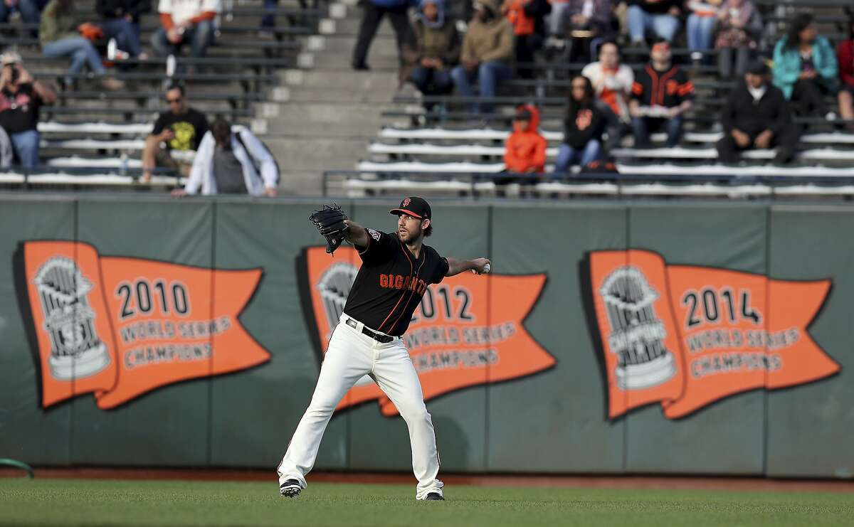 San Francisco Giants starting pitcher Madison Bumgarner (40) warms up before a baseball game against the Colorado Rockies in San Francisco, Saturday, Sept. 15, 2018. (AP Photo/Scot Tucker)
