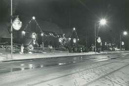 The Midland Courthouse is lit up for Christmas. Winter 1970