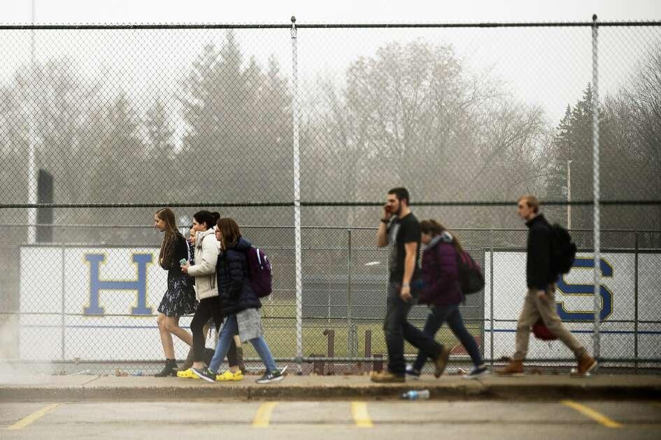 Students evacuate from Midland High School after a lockdown on Friday afternoon, Dec. 14, 2018. (Katy Kildee/kkildee@mdn.net)