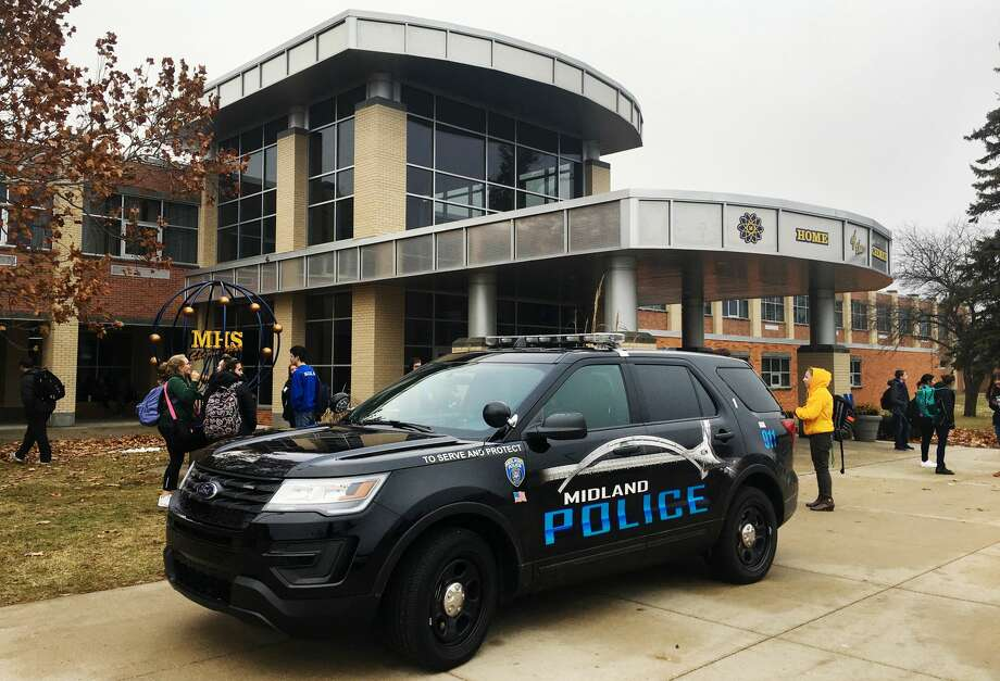 Students evacuate from Midland High School after a lockdown on Friday afternoon, Dec. 14, 2018. (Katy Kildee/kkildee@mdn.net) Photo: (Katy Kildee/kkildee@mdn.net)