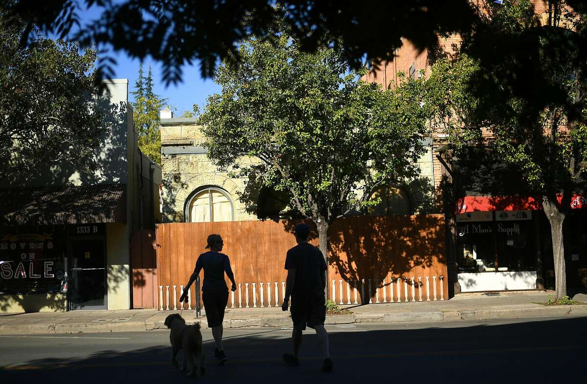 Pedestrians cross Lincoln Ave. as downtown Calistoga, Calif, remains without power on Monday, Oct. 15, 2018. Most businesses in town remained closed after PG&E cut electric service in hopes of preventing fires amid red flag fire warnings.