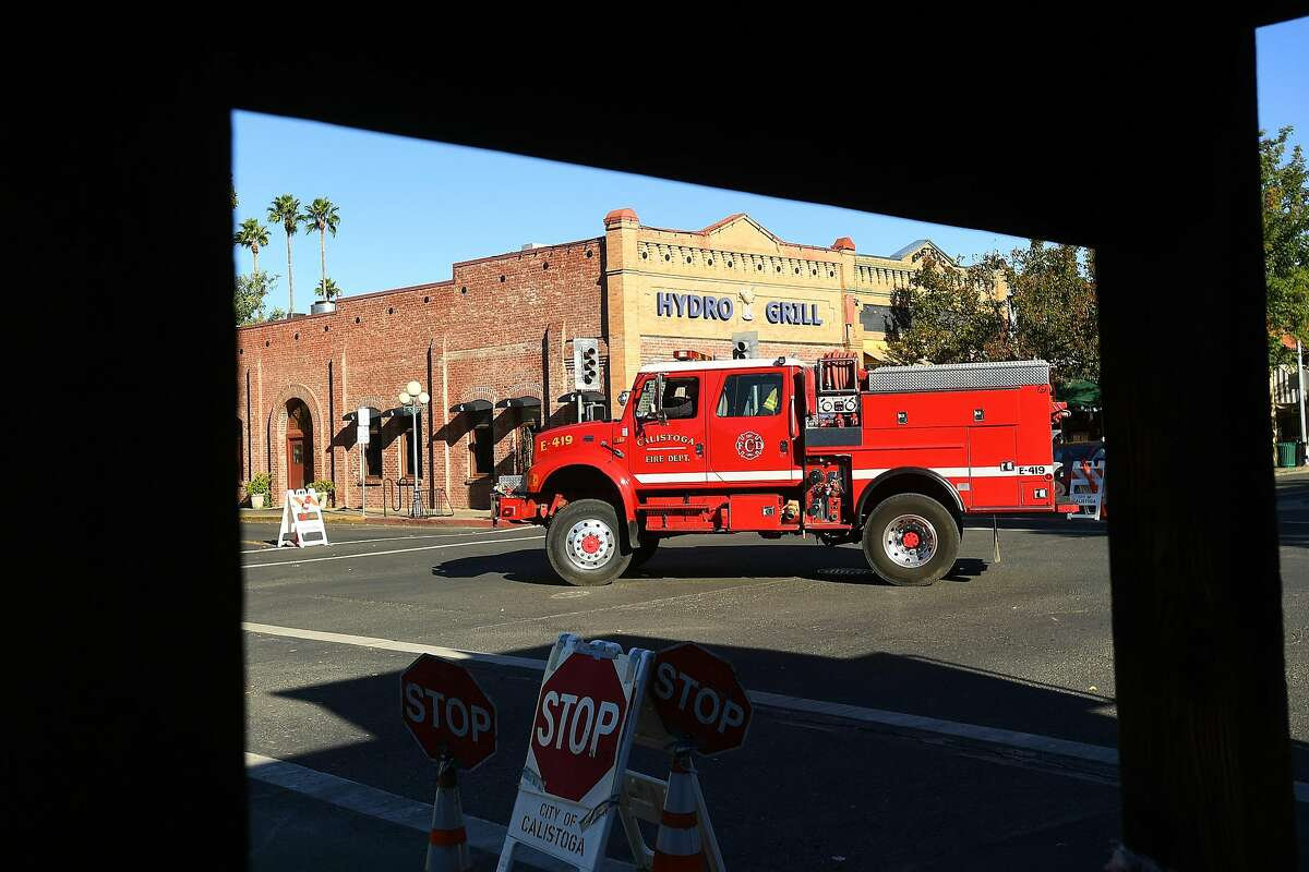 A fire truck turns onto Lincoln Ave. as downtown Calistoga, Calif, remains without power on Monday, Oct. 15, 2018. Most businesses in town remained closed after PG&E cut electric service in hopes of preventing fires amid red flag fire warnings.