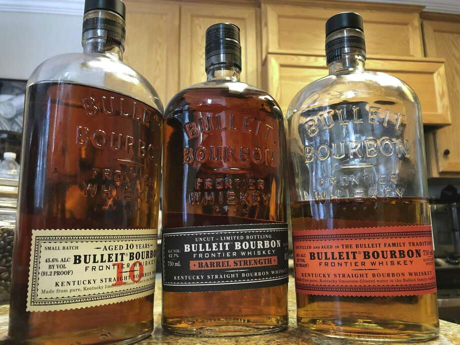 In this photo taken Tuesday, Dec. 11, 2018, bottles of Bulleit Bourbon are shown in Dublin, Calif. Spirits giant Diageo is taking a deeper plunge into bourbon and American whiskey production with plans for a new distillery in Kentucky. The $130 million venture includes plans to build a distillery and warehousing on a 144-acre site at Lebanon in Marion County, the company said Thursday, Dec. 13, 2018. The company whose brand lineup includes Bulleit bourbon is hoping to ride the wave of American whiskey sales. (AP Photo/Ben Margot) Photo: Ben Margot / Associated Press / Copyright 2018 The Associated Press. All rights reserved.