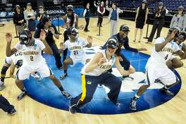 California's team celebrates after their win over Georgia during the second half in a regional final in the NCAA women's college basketball tournament, Monday, April 1, 2013, in Spokane, Wash. California beat Georgia 65-62. (AP Photo/Jed Conklin)