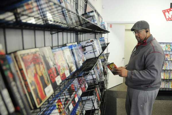 Customer Chuck Broadnax browses the new releases at Movie Exchange at 11803 Wilcrest Friday Dec.14,2018.