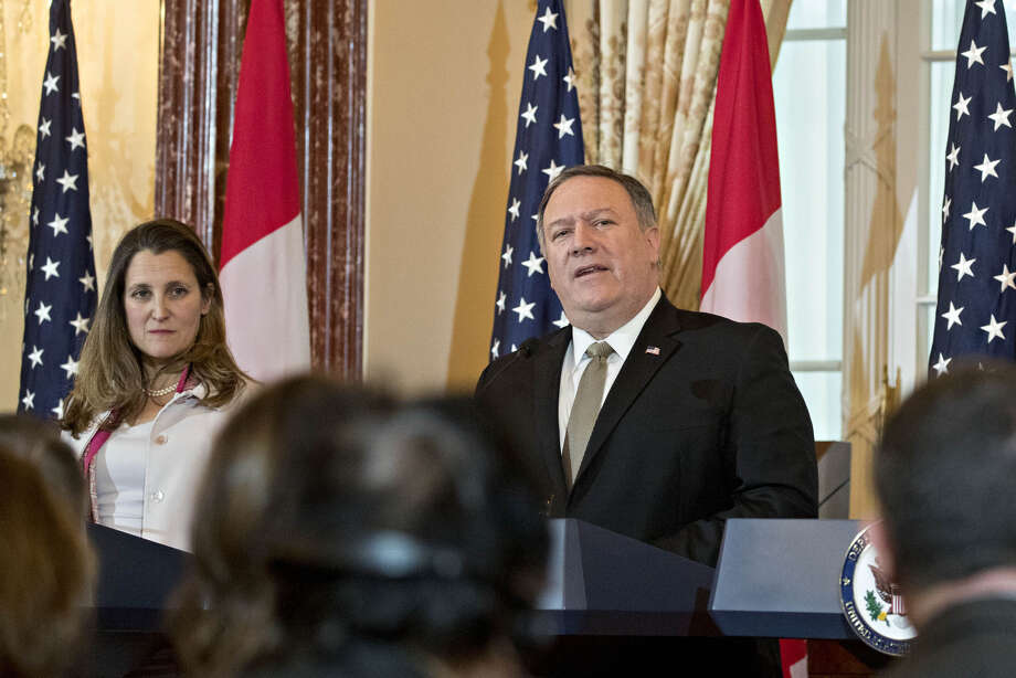 Secretary of State Mike Pompeo, speaks as Chrystia Freeland, Canada's minister of foreign affairs, listens at a news conference during a U.S.-Canada 2+2 ministerial meeting at the State Department in Washington, D.C. on Dec. 14, 2018. Photo: Bloomberg Photo By Andrew Harrer / © 2018 Bloomberg Finance LP