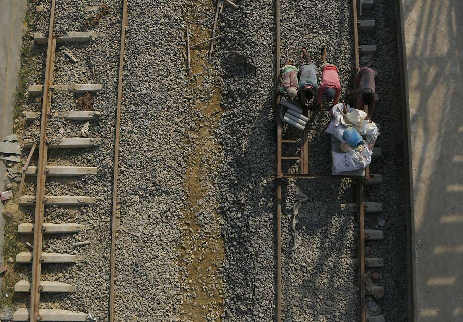 Construction laborers work at the terminal train station at near Janakpur, Nepal from where a new rail line connects to Jay Nagar in the Indian state of Bihar. Photo: Niranjan Shrestha / Associated Press