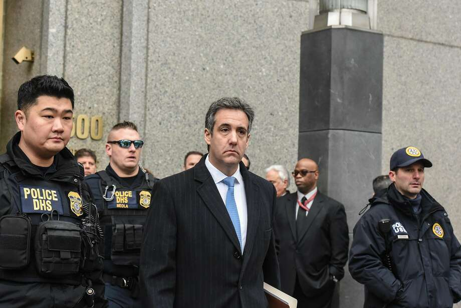 Michael Cohen, center, the former lawyer for President Donald Trump, exits federal court after his sentencing in Manhattan, Dec. 12, 2018. Cohen said he knew arranging payments during the campaign to quiet two women who claimed to have had affairs with the candidate was wrong. He said Trump knew it was wrong at the time, too. (Stephanie Keith/The New York Times) Photo: STEPHANIE KEITH, NYT