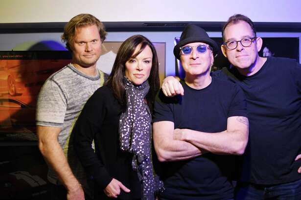 Moving in Stereo, featuring Scott Persson, left, Suzy Bessett, Phil LoPresti, and Mark Bridgman, gets the crowd moving at special holiday show on Saturday, Dec. 15 at at Bobby Q?'s Cue & Co., 11 Merwin St., Norwalk.