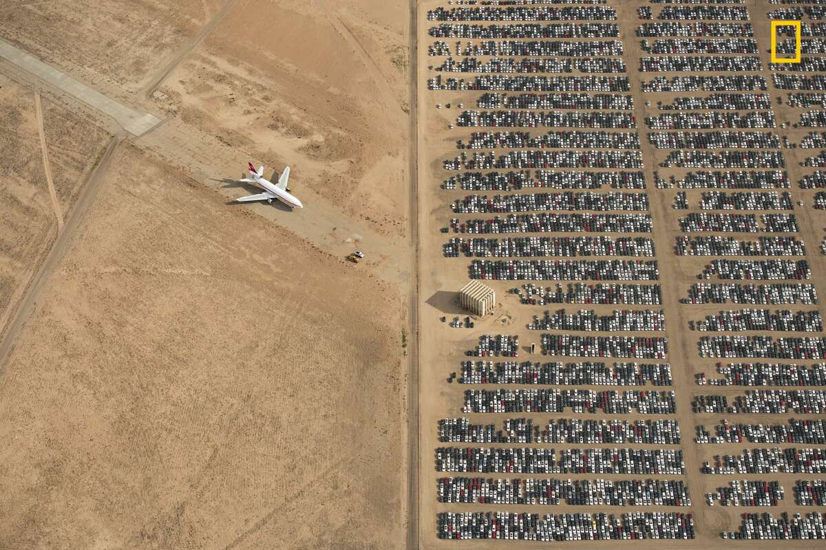 Winners of the 2018 National Geographic Photo Contest, Grand Prize Winner Thousands of Volkswagen and Audi cars sit idle in the middle of California's Mojave Desert. Models manufactured from 2009 to 2015 were designed to cheat emissions tests mandated by the U.S. Environmental Protection Agency. Following the scandal, Volkswagen recalled millions of cars. By capturing scenes like this one, I hope we will all become more conscious of and more caring toward our beautiful planet. Link: https://yourshot.nationalgeographic.com/photos/12295249
