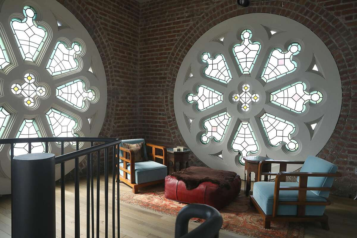 View of stained glass windows just under the dome of Saint Joseph's Arts Society church on Tuesday, Oct. 16, 2018, in San Francisco, Calif.