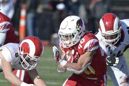 Photographs from the Connecticut high school Class LL football championship game between Greenwich and New Canaan high schools, Saturday morning, December 8, 2018, at Boyle Stadium, Stamford High School, Stamford, Conn.