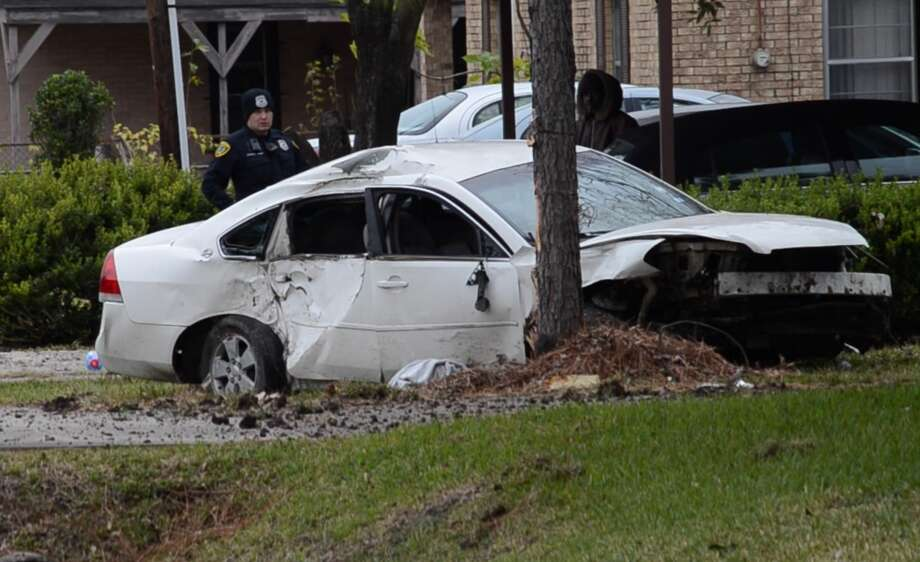 A driver is dead after losing control and slamming into a tree Friday in northeast Houston. Photo: Jay R. Jordan
