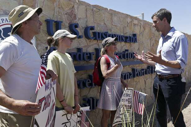 "U.S. Rep. Beto O'Rourke speaks with Megan Matson, Leo Kostelnik and their daughter, Cass Kostelnik, 15, all of Bolinas, CA, after O'Rourke toured the ""tent city,"" built to house immigrant children separated from their parents after crossing illegally into the U.S. or seeking asylum, at the Marcelino Serna Port of Entry in Tornillo on June 23, 2018."