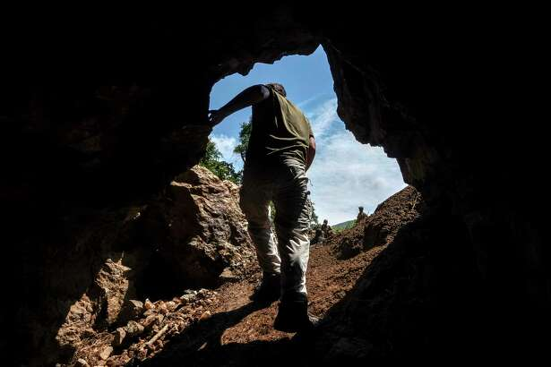 Jonathan Towner, a scientist with the Centers for Disease Control and Prevention, climbs out of a mining cave in Uganda. The Marburg virus claimed the life of one miner and infected several others working there in 2007.