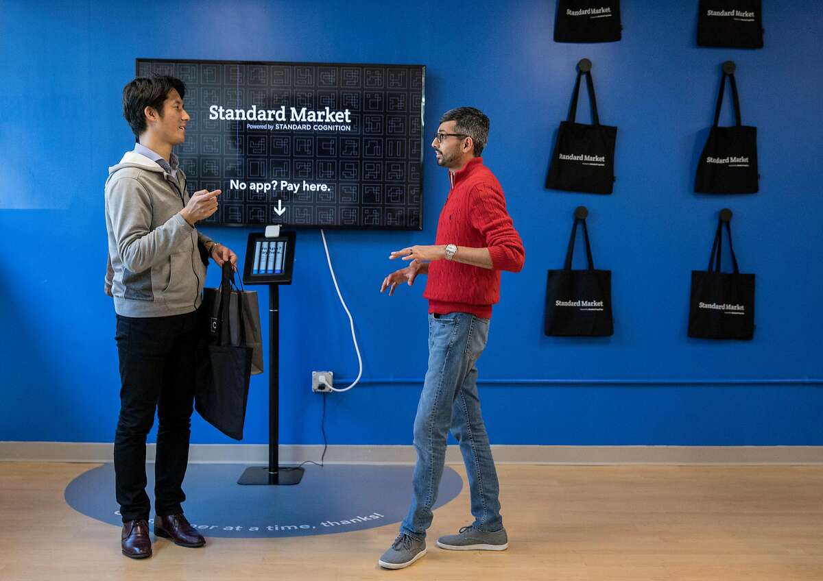 Store manager Chintan Maniar (right) chats with customer Satoshi Ota as he shops at Standard Market, a cashier-less convenience store in San Francisco, Calif. Wednesday, Nov. 28, 2018.