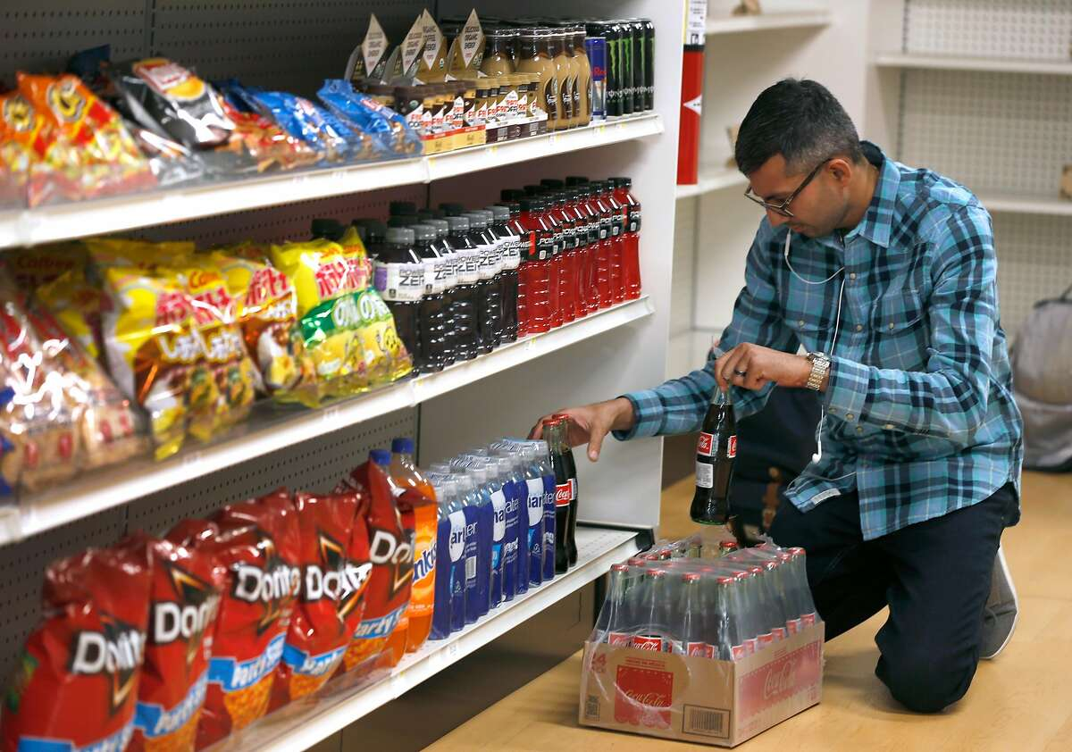 Manager Chintan Maniar restocks the shelves at the Standard Market cashless store on Market Street in San Francisco, Calif. on Thursday, Nov. 15, 2018.