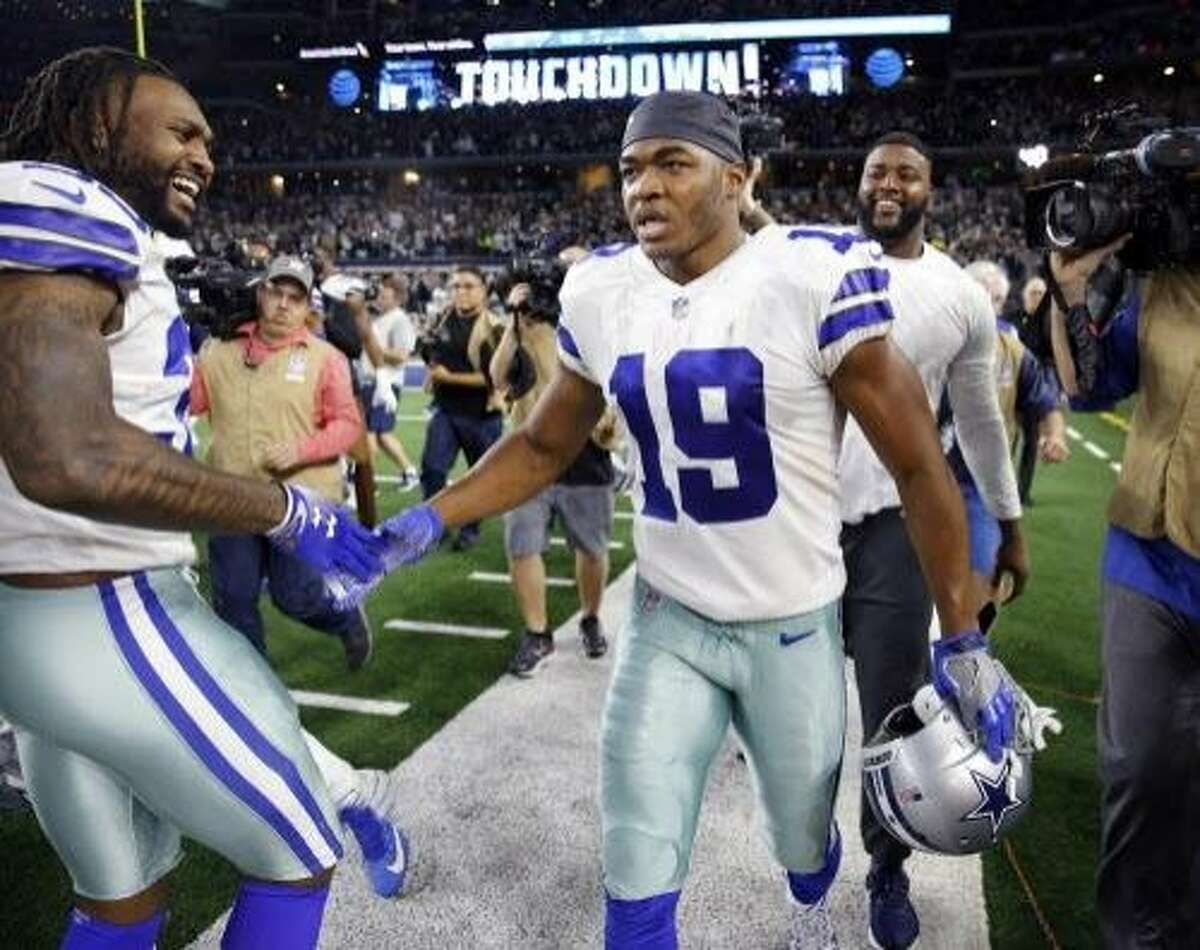 Dallas Cowboys wide receiver Amari Cooper (19) is congratulated by teammates after scoring the game-winning touchdown in the overtime against the Philadelphia Eagles on Sunday, Dec. 9, 2018 at AT&T Stadium in Arlington, Texas. (Tom Fox/Dallas Morning News/TNS)