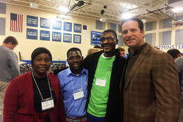 From left, Salome, Mwansa, and Lawrence meet former St. Louis Cardinals Manager Mike Matheny at Westminster Christian Academy in St. Louis. African Vision of Hope in Maryville flew the three school staff members to the U.S. part of a new partnership.
