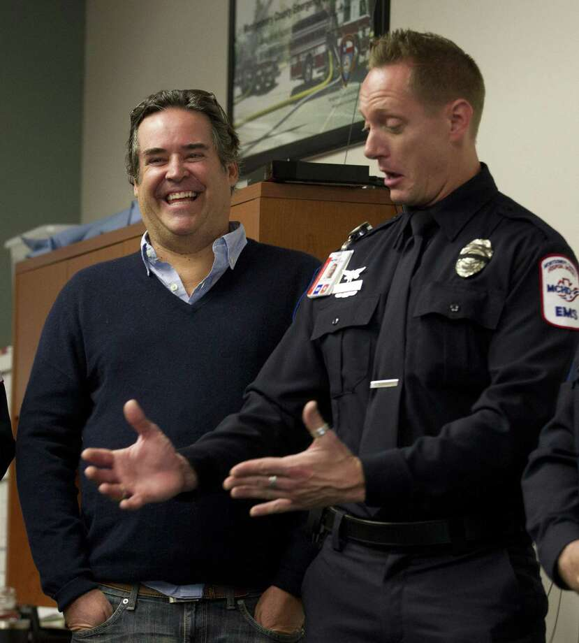 Chris DeHart shares a laugh as Montgomery County Hospital District Paramedics James Joublanc recounts helping deliver DeHart's eight-month-old daughter, Addison, as members of the Montgomery County Hospital District and Montgomery Fire Department reunite with the family, Friday, Dec. 14, 2018, in Montgomery. Photo: Jason Fochtman, Houston Chronicle / Staff Photographer / © 2018 Houston Chronicle