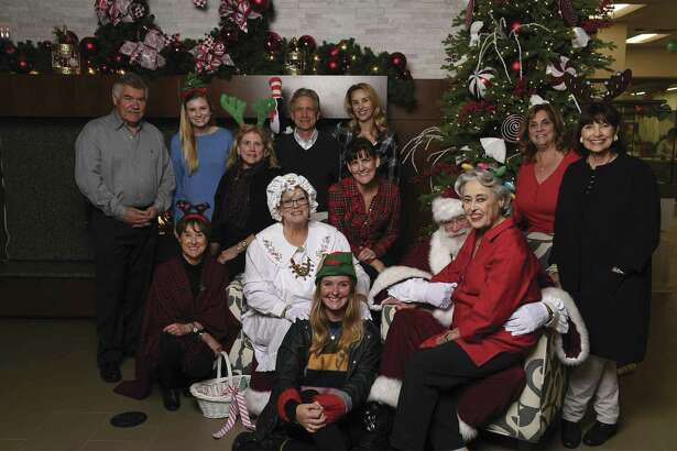 John Daugherty, Realtors agents gathered to spread holiday cheer at the Ronald McDonald House.