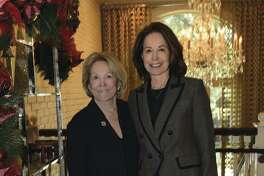 Julie Greenwood, left, and Linda King, owners of Greenwood King Properties, greeted guests at the holiday luncheon.
