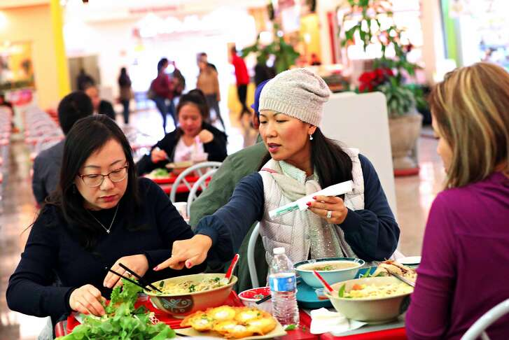 Minh Cannon (center) talks with Cindy Tang (left) and Tricia Lu (right), all of Union City, as they enjoy a lunch together at the Grand Century Shopping Mall on Friday, December 14,  2018  in San Jose, Calif.
