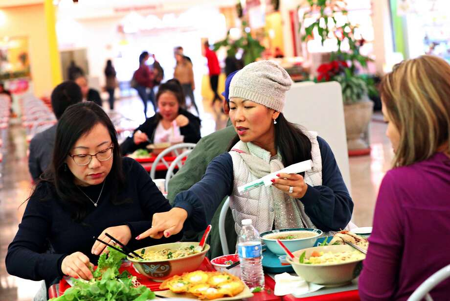 Cindy Tang (left), Minh Cannon and Tricia Lu, all of Union City, eat lunch together at the Grand Century Shopping Mall in San Jose's Little Saigon neighborhood. Photo: Lea Suzuki / The Chronicle