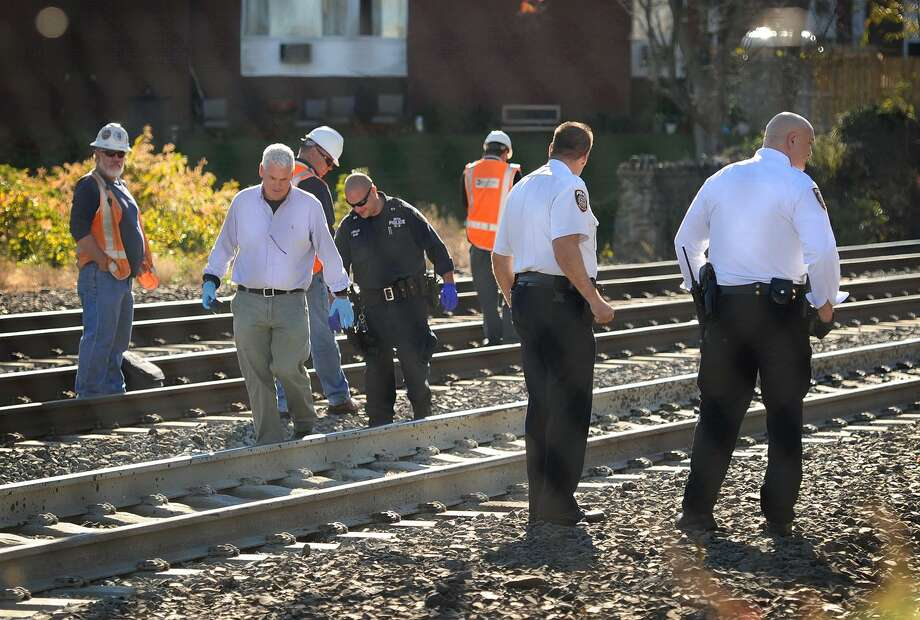 Investigators search the tracks for the remains of a woman killed by an Amtrak train in Milford in 2014. Photo: Brian A. Pounds / Hearst Connecticut Media / Connecticut Post