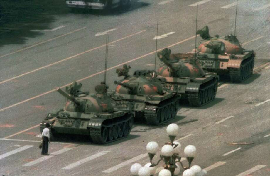 A Chinese man blocks a line of tanks heading east on Beijing's Changan Blvd. after Chinese forces crushed a pro democracy demonstration in Tiananmen Square on June 5, 1989. This crackdown was a disater for then-President George H.W. Bush who sought to preserve U.S./China relations. Photo: JEFF WIDENER /AP / AP