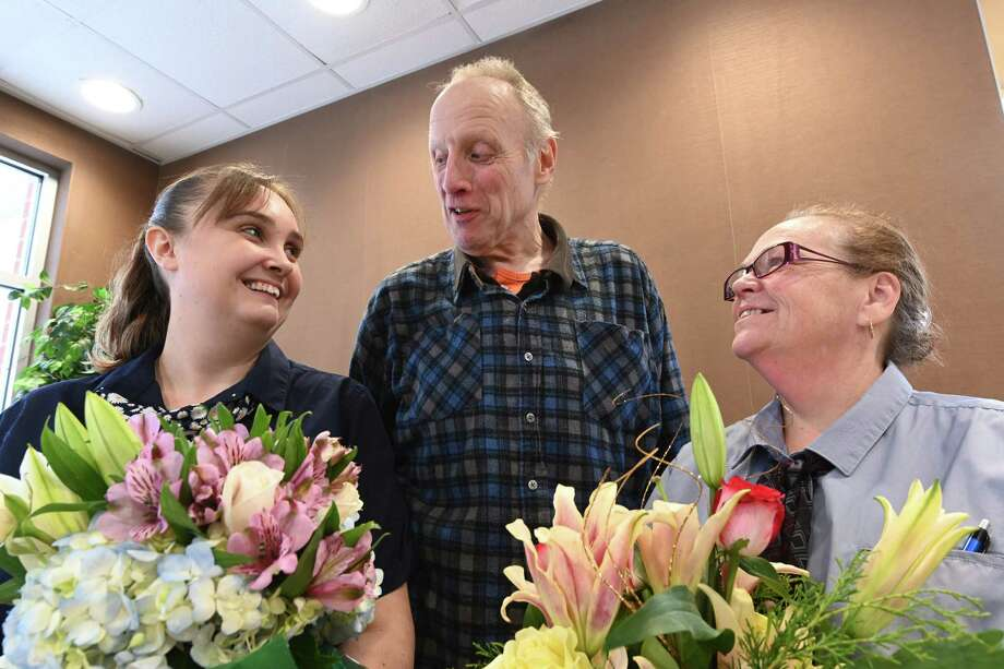 Heart patient Dennis King presents Paige Eaton, left and Karen Robison, Thursday Dec. 13, 2018 in Saratoga Springs, N.Y.,  both of whom were responsible in saving King's life when he had a severe heart attack at the McDonald's restaurant on Broadway on August 23rd. (Skip Dickstein/Times Union) Photo: SKIP DICKSTEIN, Albany Times Union / 20045710A