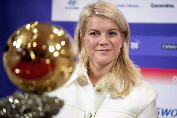 Lyon's Norwegian forward Ada Hegerberg, winner of 2018 Women's Ballon D'Or award for best player of the year, poses with the trophy during a press conference with Lyon's President at the Groupama training center in Lyon, central eastern France, on December 4.