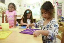 Rising kindergartener Carla Rodriquez, right, plays at Gateway School in Greenwich, Conn. Wednesday, Aug. 8. Kindergarten should be about play and social interaction and less about academics.