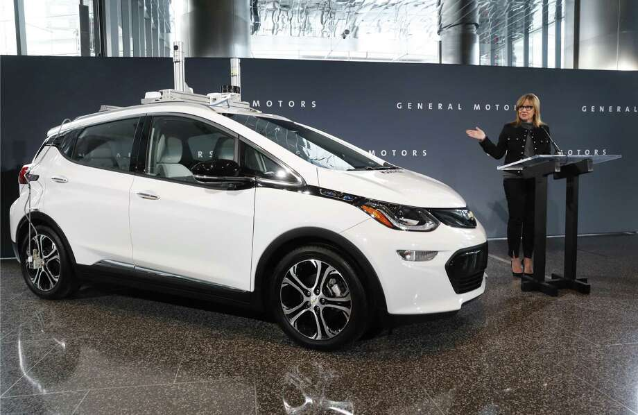 General Motors Chairman and CEO Mary Barra speaks next to a autonomous Chevrolet Bolt electric car in Detroit in 2016. President Trump's recent threat to cut subsidies for electric vehicles should be viewed with alarm. Photo: Paul Sancya /Associated Press / Copyright 2016 The Associated Press. All rights reserved.