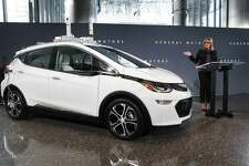 General Motors Chairman and CEO Mary Barra speaks next to a autonomous Chevrolet Bolt electric car in Detroit in 2016. President Trump's recent threat to cut subsidies for electric vehicles should be viewed with alarm.