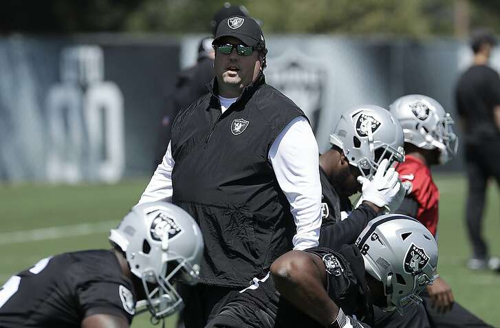 Oakland Raiders defensive coordinator Paul Guenther watches as players stretch during practice at the team's NFL football facility in Alameda, Calif., Tuesday, April 24, 2018. (AP Photo/Jeff Chiu)