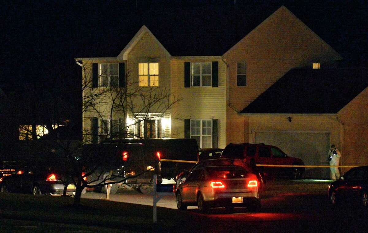 Police have blocked off Adams Circle and are investigating a home there Friday evening Dec. 14, 2018 in Ballston Spa, NY. (John Carl D'Annibale/Times Union)