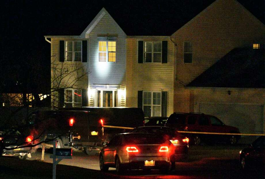 Police have blocked off Adams Circle and are investigating a home there Friday evening Dec. 14, 2018 in Ballston Spa, NY.  (John Carl D'Annibale/Times Union) Photo: John Carl D'Annibale, Albany Times Union
