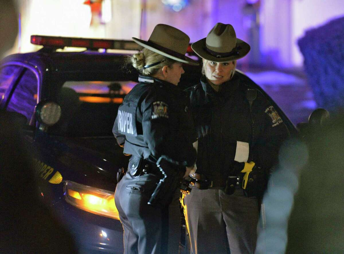 State troopers block off Adams Circle as they investigate a home there Friday evening Dec. 14, 2018 in Ballston Spa, NY. (John Carl D'Annibale/Times Union)