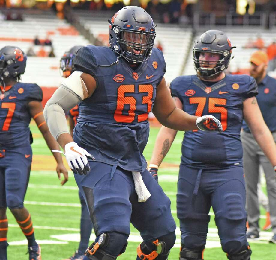 Syracuse offensive lineman Evan Adams, a resident of Norwalk, warms up before the start of a game against Boston College at the Carrier Dome in Syracuse, N.Y. last season. Photo: John Nash / Hearst Media Connecticut