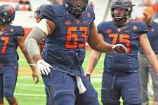 Syracuse offensive lineman Evan Adams, a resident of Norwalk, warms up before the start of a game against Boston College at the Carrier Dome in Syracuse, N.Y. last season.