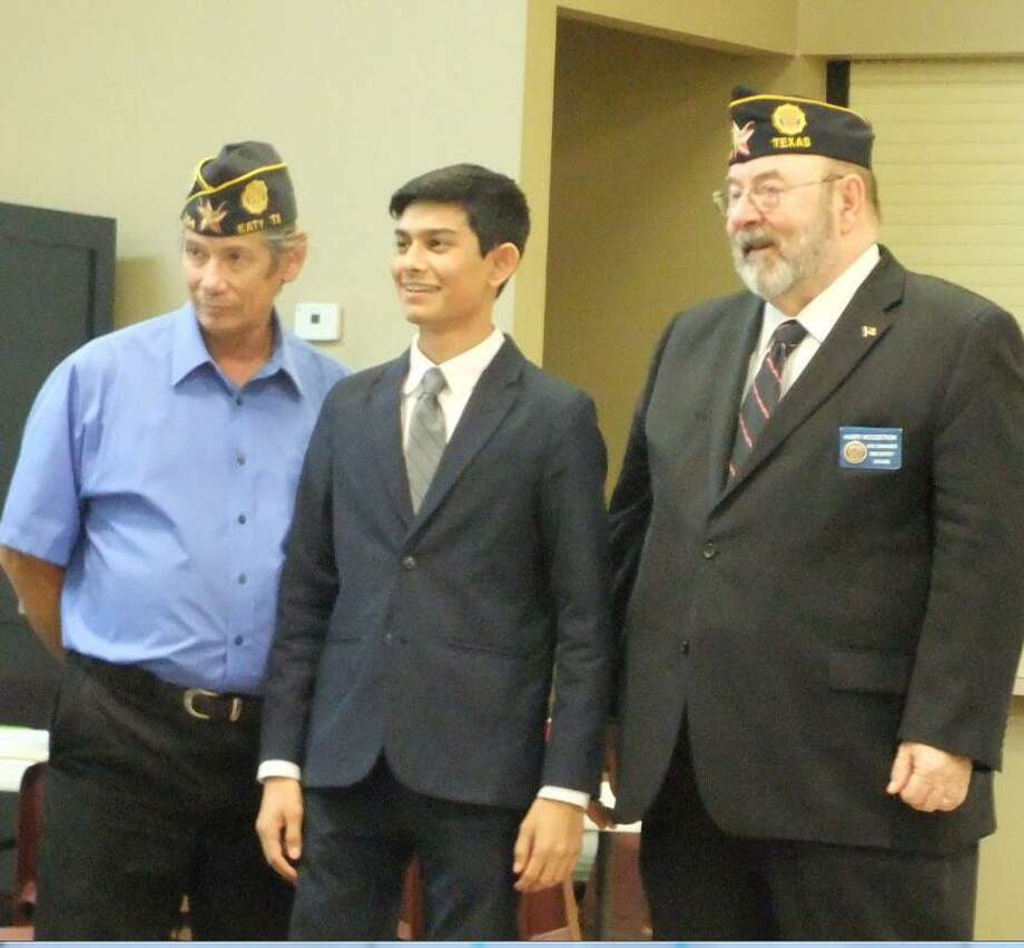 Sid Puranik, a senior at Tompkins High School, won a $250 college scholarship in the 2018-19 oratorical contest sponsored by American Legion Post 164 in Katy. He's pictured on Nov. 28 with Post 164 members Ernie Cormier, left, and Harry Woodstrom. The next level of competition will be on Jan. 9 in Pasadena for Houston-area winners. Photo: Forrest Croom / Forrest Croom