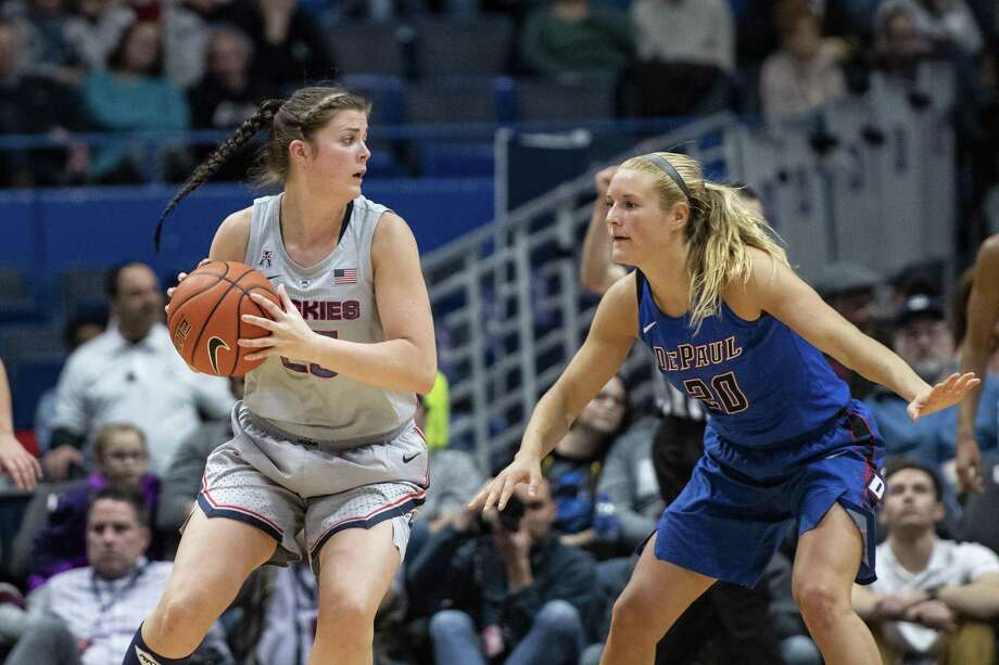STORRS, CT - NOVEMBER 28: Connecticut Huskies Forward Kyla Irwin (25) looks to pass the ball with DePaul Blue Demons Guard Kelly Campbell (20) defending during the second half of the DePaul Blue Demons versus the Connecticut Huskies on November 28, 2018, at the XL Center in Hartford, CT. (Photo by Gregory Fisher/Icon Sportswire via Getty Images) Photo: Icon Sportswire / Icon Sportswire Via Getty Images / ©Icon Sportswire (A Division of XML Team Solutions) All Rights Reserved ©Icon Sportswire (A Division of XML Team Solutions)
