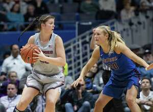 STORRS, CT - NOVEMBER 28: Connecticut Huskies Forward Kyla Irwin (25) looks to pass the ball with DePaul Blue Demons Guard Kelly Campbell (20) defending during the second half of the DePaul Blue Demons versus the Connecticut Huskies on November 28, 2018, at the XL Center in Hartford, CT. (Photo by Gregory Fisher/Icon Sportswire via Getty Images)