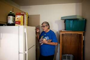 Michael Dennis, unloading food from his kitchen to donate to a church pantry in Sebastopol, in his new apartment in Santa Rosa, California, December 8th, 2018. When he was homeless , for 4 months he would sleep in his truck in the church parking lot.  Michael Dennis is a 69 year old disabled man who over the past 2 years has been living in his automobile which he parked in a Sebastopol church parking lot. He was able to get a HUD voucher and use support from the Season of Sharing Fund to move into senior affordable housing.