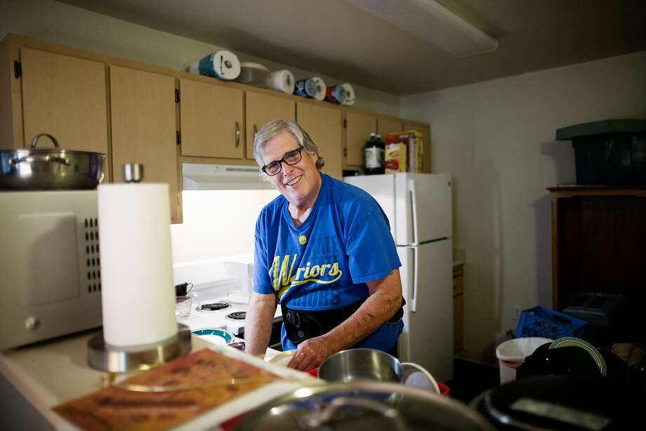 Dennis does the dishes in his new Santa Rosa apartment. Photo: Talia Herman / Special To The Chronicle