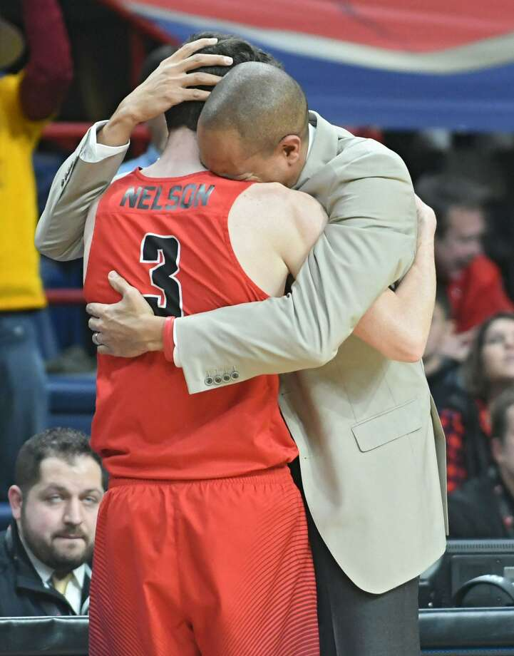 Fairfield's Tyler Nelson gets a hug from head coach Sydney Johnson after he leaves the game before a loss to Iona in the Metro Atlantic Athletic Conference Tournament's championship game at the Times Union Center on March 5. Photo: Lori Van Buren /Albany Times Union / 20043096A